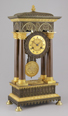 Brass casted french portico mantel clock in gothic style.