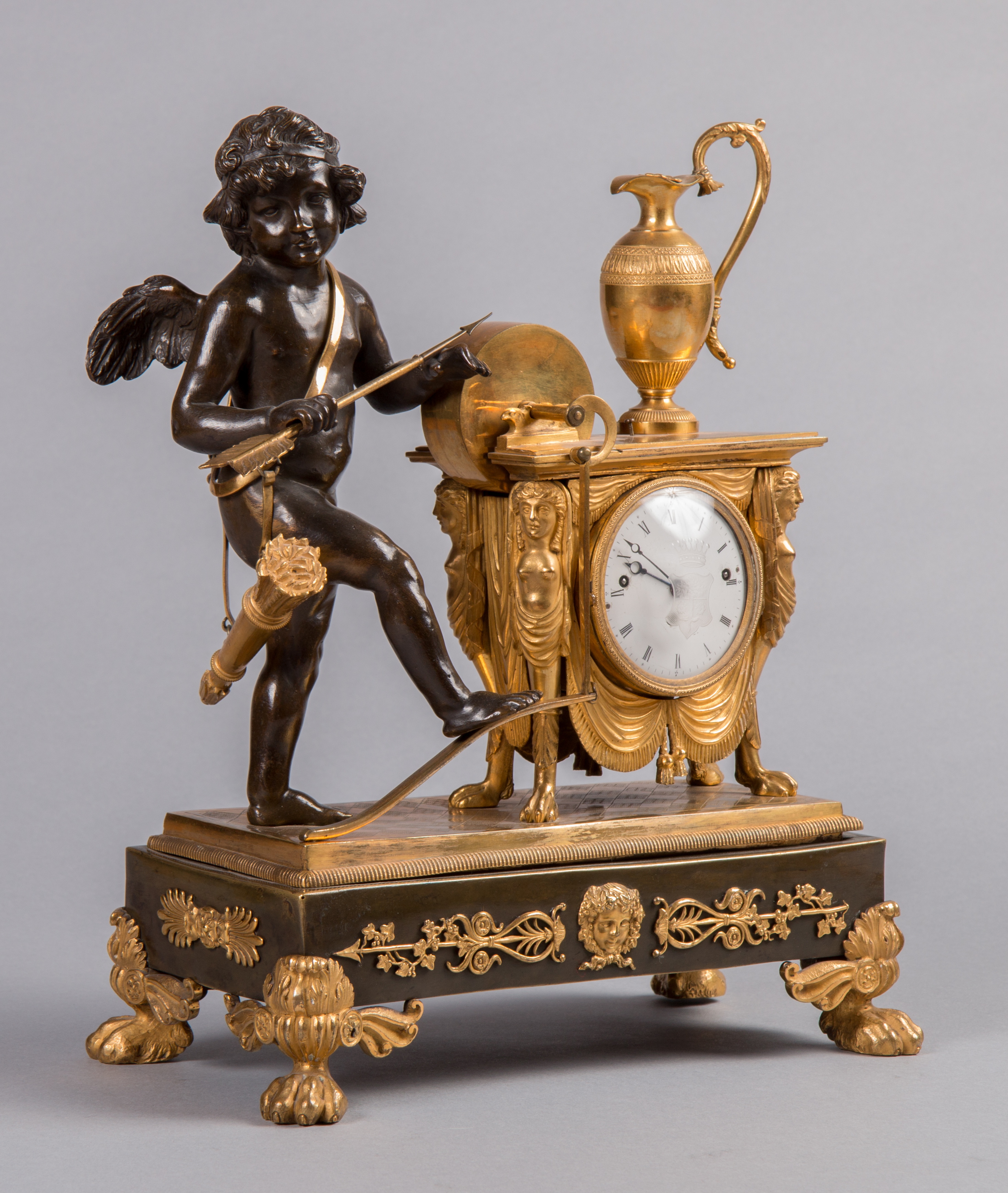 Empire mantel clock with Amor sharpening his arrow, c. 1830.