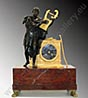 Prestigious and exclusive figural mantel clock in red marble and patinated and Ormolu bronze, representing Homer singing on the ruins of Troy .