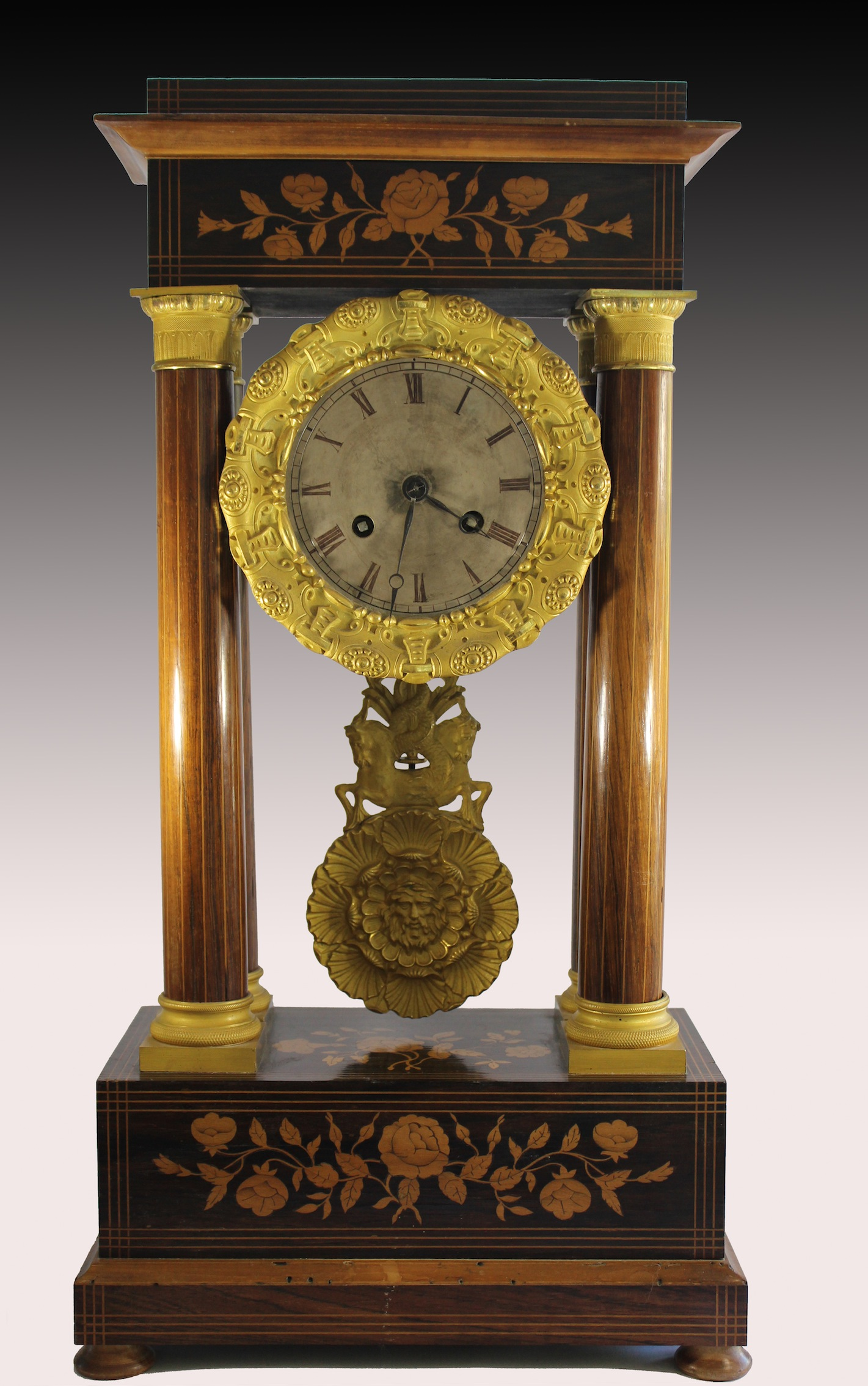 Beautiful columned portico clock, Charles X period inlaid with floral decoration in pink and lemon fillets with gilt bronze ornamentation finely crafted original mercury.