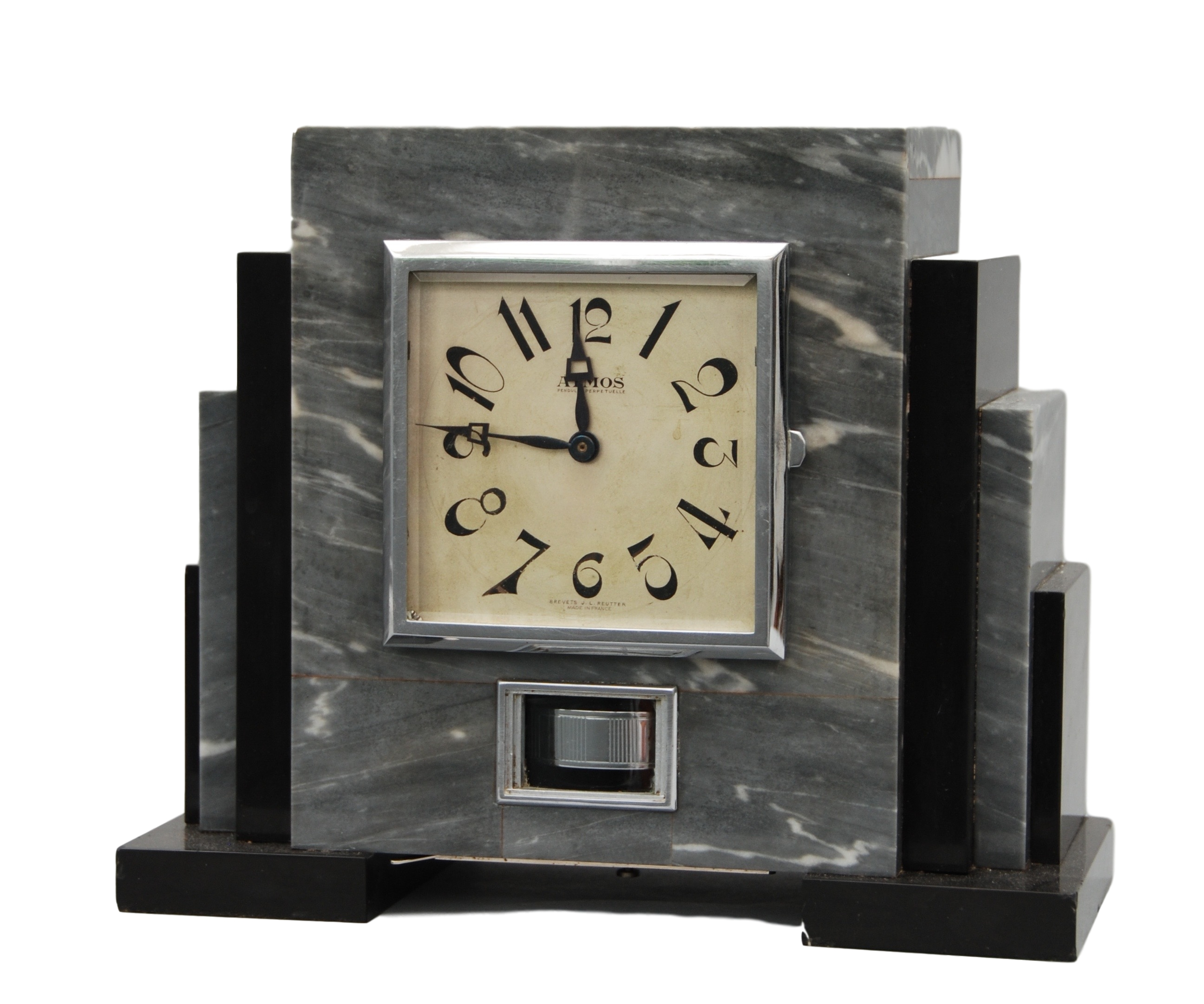 An early 20th century French marble Atmos mantel timepiece set Reutter, number 1528.