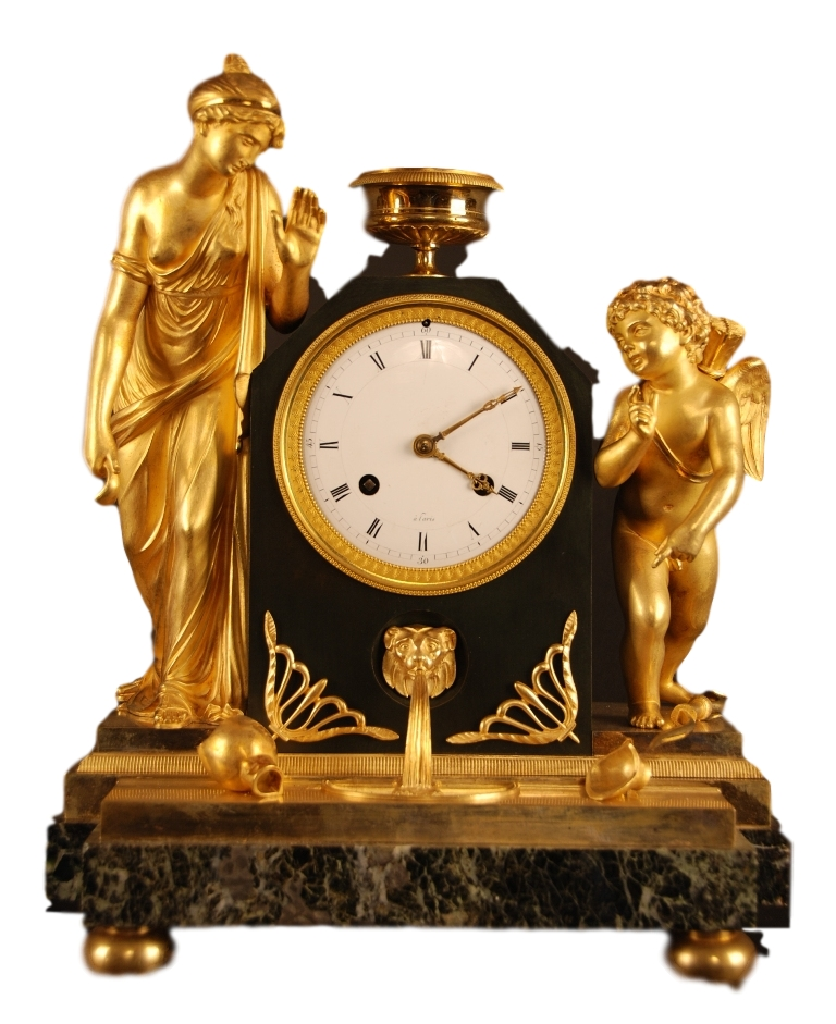 An early 19th century French patinated and gilt bronze figural mantel clock.