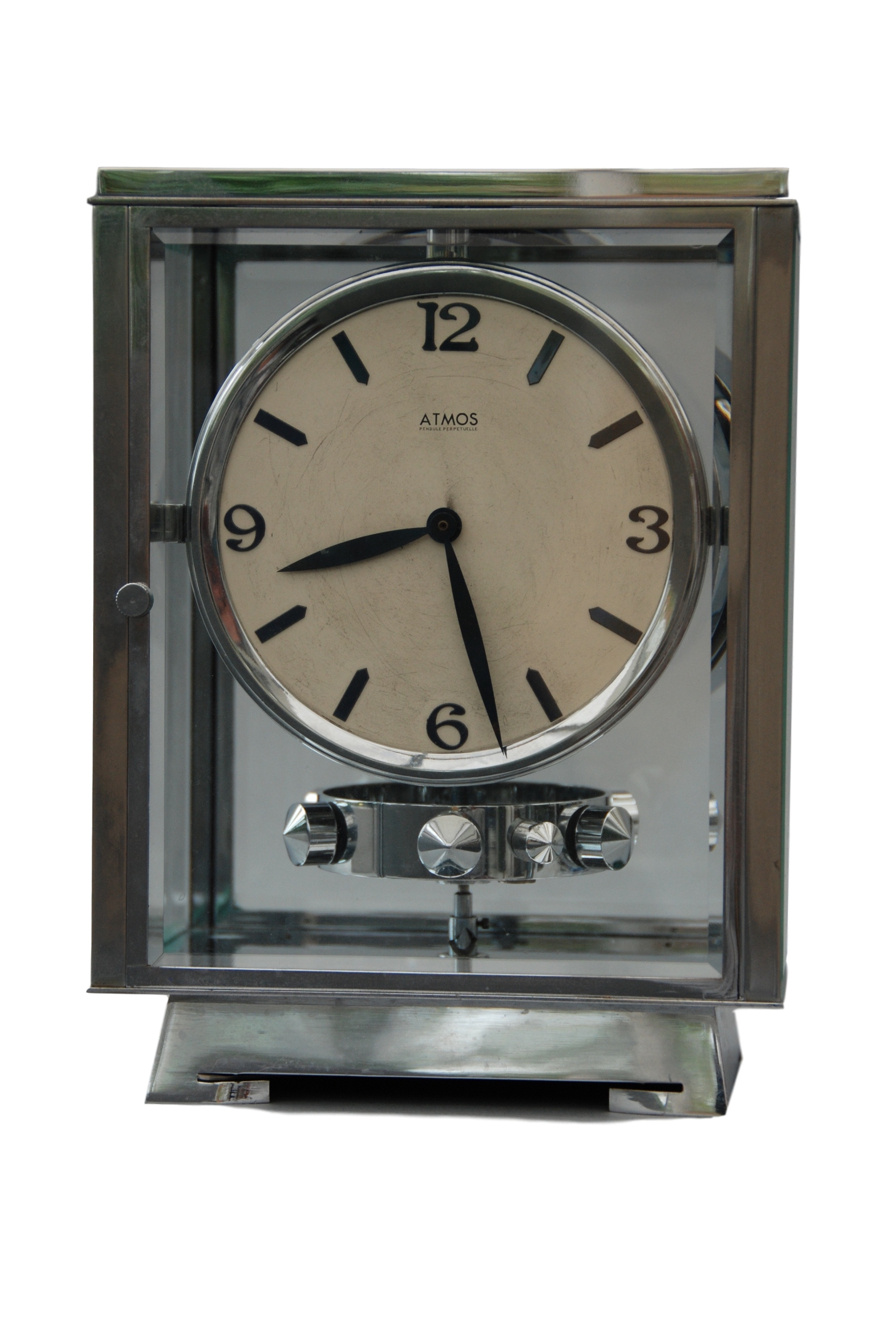 An early 1932 Rhodium plated art deco J. L. Reutter four-glass clock