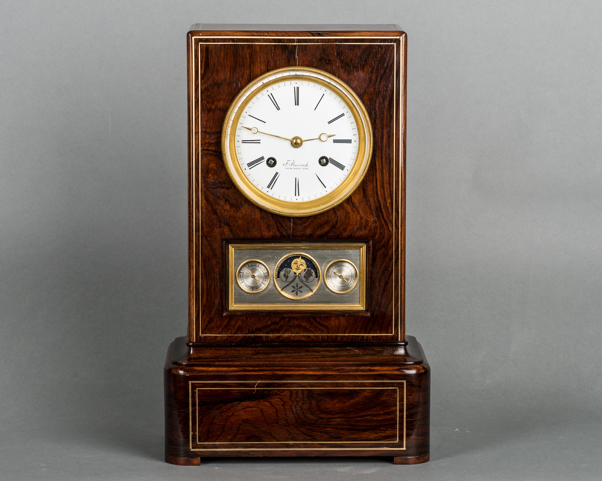 The unusual kingwood mantel clock with calendar work and moon fase, circa 1840