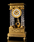 A small French Empire gilt bronze and crystal portico mantel clock, ca. 1810, height 37½cms