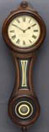 "An eglomisé paneled walnut Model No. 10 ""Figure Eight"" wall clock, by E. Howard & Co. Boston"