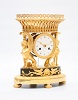 A beautiful French Empire ormolu mantel clock with griffins, circa 1800