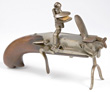 Antique German iron and brass flintlock lighter with candle holder, end 18th Century.